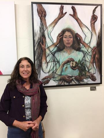 Janet Hayes with her work titled 'Self Portrait' — winner of the inaugural John Dudley Portrait Prize