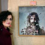 Ramak Bamzar with her winning artwork 'The Dark Beauty'